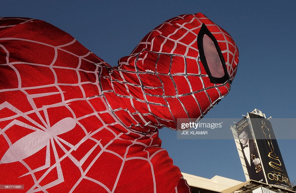 A street performer garbed as Spiderman strikes a pose backed by the first billboard announcing this year's upcoming OSCARS, the 85th Academy Awards, in front of the Dolby Theatre in Hollywood, California, on February 14, 2013. The ceremony is scheduled for February 24, 2013. AFP PHOTO/JOE KLAMARstrikes a pose backed by the first billboard announcing this year's upcoming OSCARS, the 85th Academy Awards, in front of the Dolby Theatre in Hollywood, California, on February 14, 2013. The ceremony is scheduled for February 24, 2013.