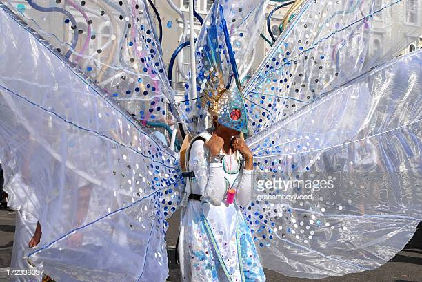 A street performer in a butterfly costume with big wings