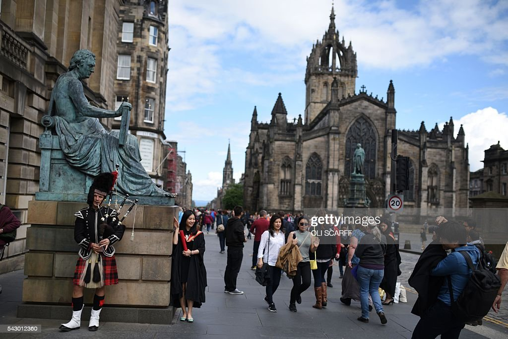 A street performer plays the bagpipes next to a statue of Scottish philosopher David Hume on the Royal Mile in Edinburgh, Scotland on June 25, 2016. Scotland wants immediate talks with the European Union on protecting its place in the bloc, after Britain's vote to leave the EU, First Minister Nicola Sturgeon said Saturday. Speaking after an emergency meeting of her cabinet, Sturgeon said it had agreed to seek 'immediate discussions with the EU institutions and other EU member states to explore all possible options to protect Scotland's place in the EU.' SCARFF