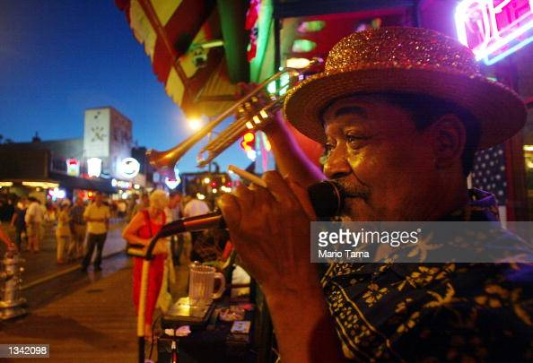 A street performer sings on Beale Street during Elvis Week August 17 2002 in Memphis Tennessee Up to 75000 fans were expected to attend Memphis'...