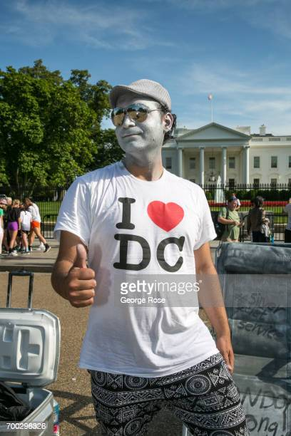A street performer wearing an 'I Heart DC' tshirt on The White House Mall gives a thumbs up on June 4 2017 in Washington DC The nation's capital the...