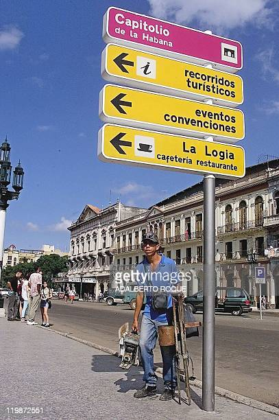 A street photographer in Havana looks for tourists 30 December 1999 Cuban tourism authorities reported that some 50000 tourists have cancelled their...