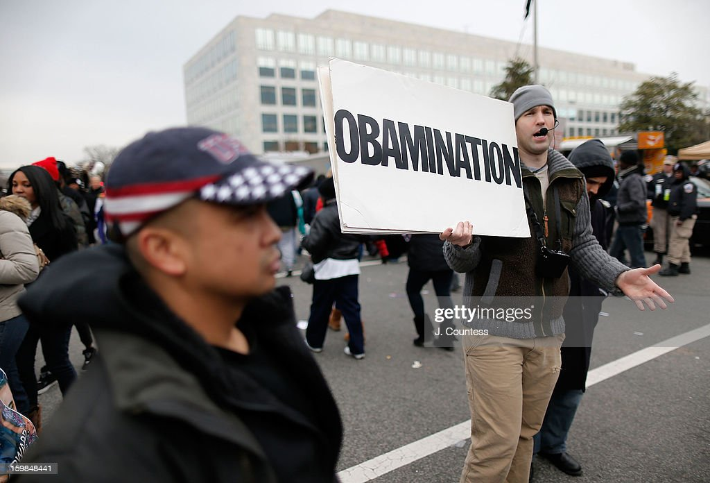 A street preacher debates with spectators enroute to watch the 57th United States Presidential Inauguration ceremony at the National Mall on January 21, 2013 in Washington, DC.