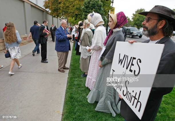 Street preacher Jerry Holt and several of his followers stand in protest to try inform Mormons of the many wives of Mormon founder Joseph Smith at...