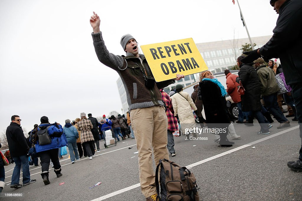 A street preacher preaches to spectators enroute to watch the 57th United States Presidential Inauguration ceremony at the National Mall on January 21, 2013 in Washington, United States.