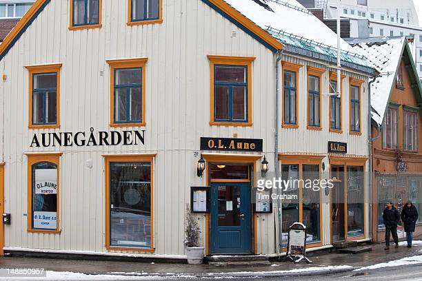 Street scene and quaint Aunegarden Restaurant in Storgata in city of Tromso in the Arctic Circle in Northern Norway