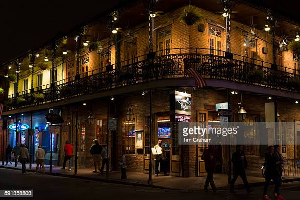 Street scene and Retrouvailles Bistro in famous Bourbon Street in French Quarter of New Orleans USA