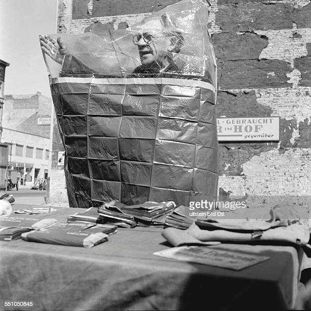 Street scene at the Potsdamer Platz a street dealer behind his merchandise shop on the cleaned bombed site at the corner of the Potsdamer Straße to...