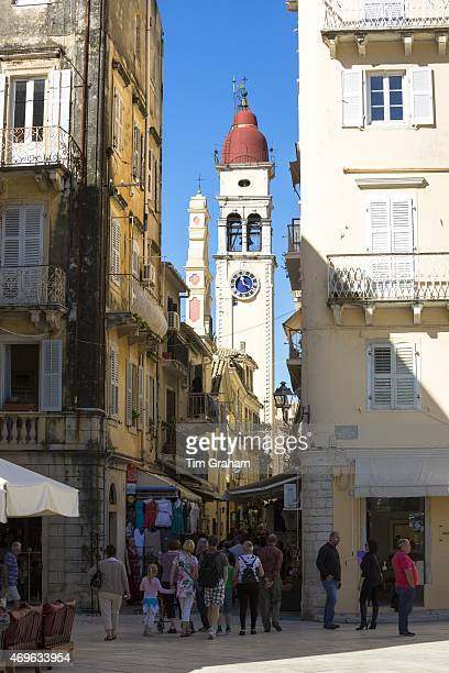 Street scene by Spianada and Church of Saint Spyridon with traditional clock belltower in Kerkyra Corfu Town Greece