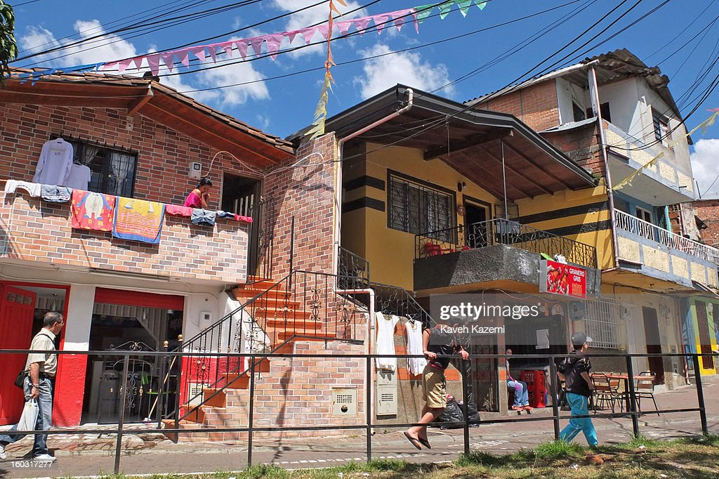 A street scene in a small alley way on January 5, 2013 in Medellin, Colombia. The notorious slums of Medellin have gone through urban and educational projects to improve the quality of life for its residence.