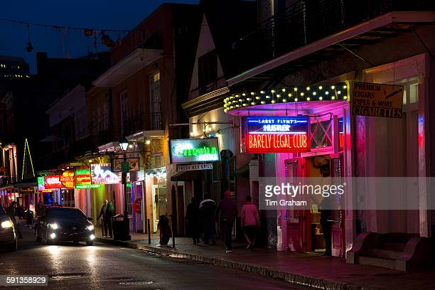 Street scene in famous Bourbon Street in French Quarter of New Orleans USA