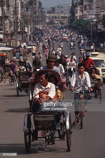 A street scene in Ho Chi Minh City with traffic which mostly consists of bicycles motorcycles and cyclos Vietnam's ubiquitous taxis