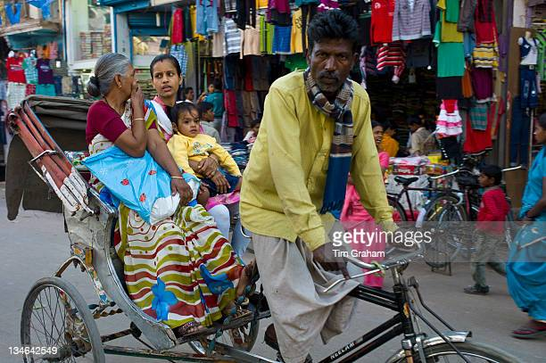 Street scene in holy city of Varanasi Benares Northern India