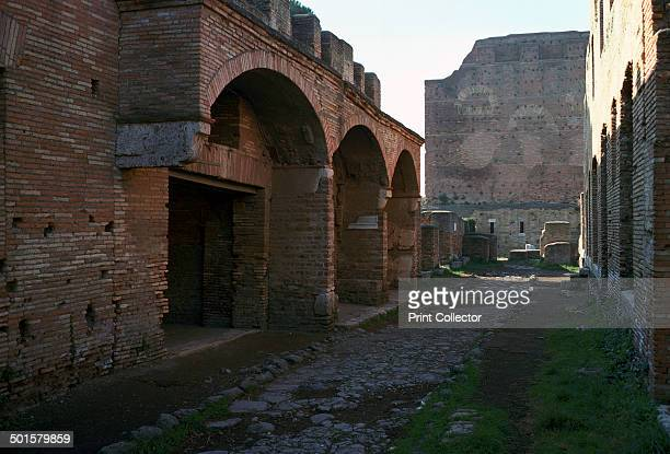 Street scene in the Roman city and port of Ostia On the left are shops 2nd century