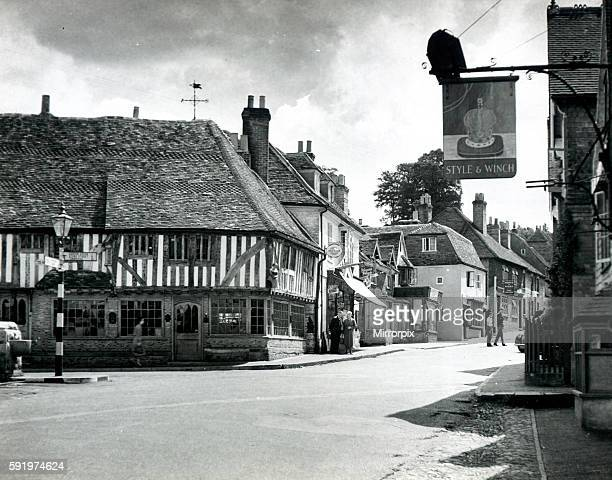 Street scene in the village of Ightham in Kent showing the local pubs and shops Circa 1935