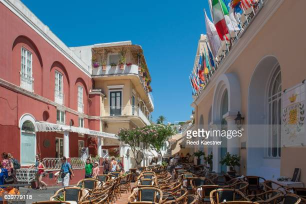 Street scene showing outdoor seating and flags  in Capri, Italy
