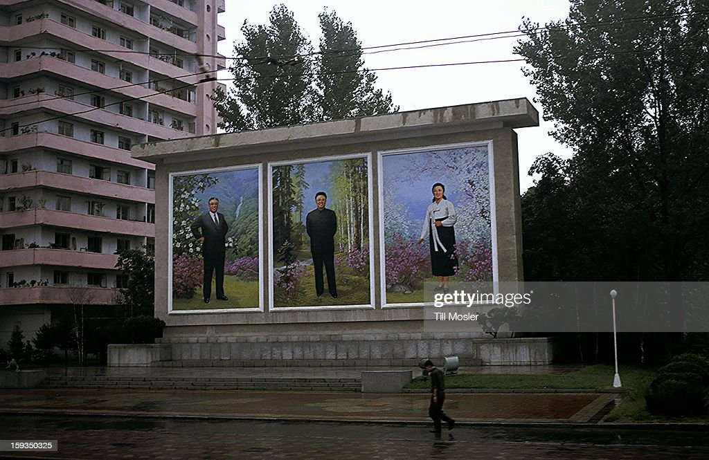 CONTENT] Street scene with a large mural wich shows the portraits of Kim Il Sung, Kim Jong Il and Kim Jong Suk, in the city centre of Hamhung (DPRK, Hamgyong Namdo province) Sept 2011