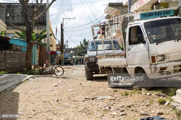 Santa Domingo Dominican Republic November 30 2012 Street scene with broken road in the poor neighbourhood 'Los Alcarrizos' in Santa Domingo