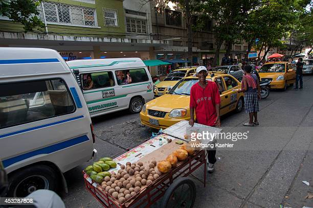 Street scene with fruit vendor in Santa Marta Colombia