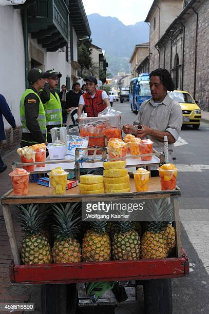 Street scene with fruit vendors in La Candelaria the old town of Bogota Colombia
