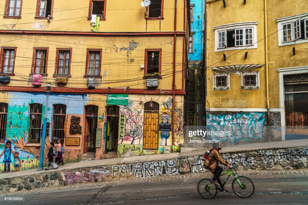 Street scene with murals, Cerro Concepcion, man on bicycle in foreground, Valparaiso, UNESCO World Heritage Site, Chile : Stock Photo