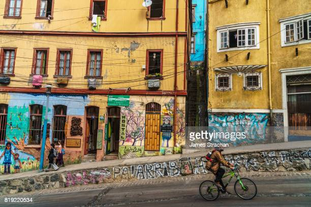 Street scene with murals, Cerro Concepcion, man on bicycle in foreground, Valparaiso, UNESCO World Heritage Site, Chile