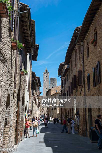 Street scene with towers in the medieval walled hill town of San Gimignano in Tuscany Italy