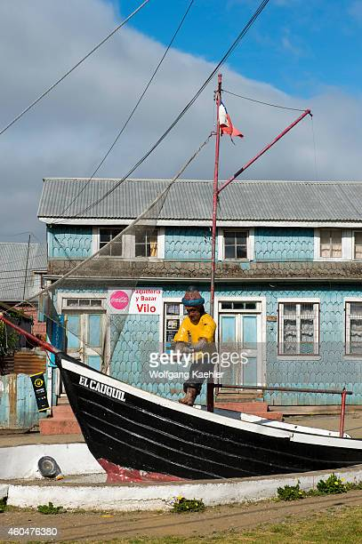 Street scenes with a statue and boat of a fisherman in Dalcahue Chiloe Island in southern Chile