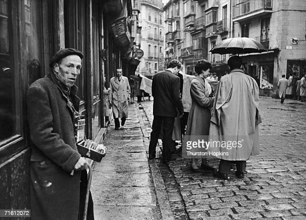 A street seller in Madrid June 1956 Original Publication Picture Post 8493 Madrid unpub