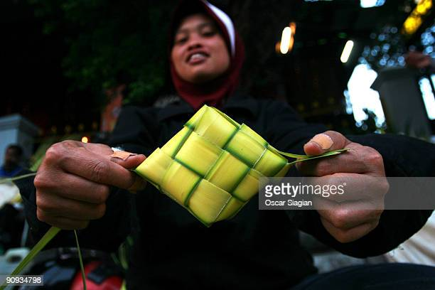 Street sellers sell wrap for 'Ketupat' Ketupat is a special food that is usually cooked for Eid alFitr celebrations on September 18 2009 in...
