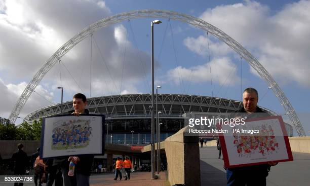 Street sellers with Chelsea and Man Utd team cartoons at the new Wembley Stadium on the morning of the FA Cup Final against Chelsea