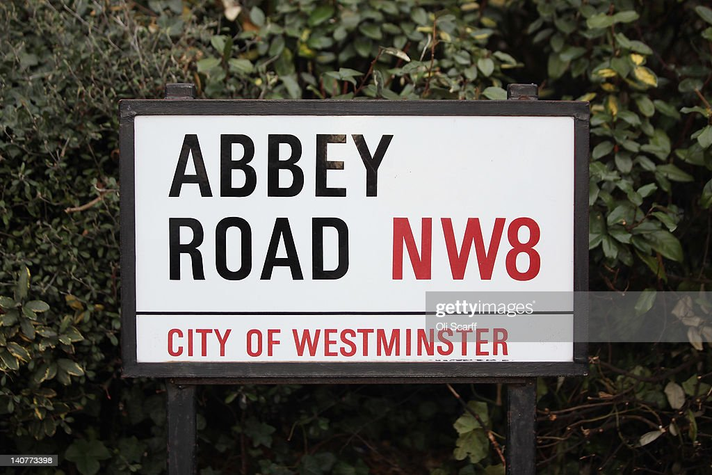 A street sign for 'Abbey Road' in St John's Wood, home to Abbey Road Studios, on March 5, 2012 in London, England. Abbey Road in North London has been made famous by 1960s bands such as The Beatles and Pink Floyd who recorded in Abbey Road Studios. In particular, the cover of The Beatles' 1969 album 'Abbey Road' features the band on the pedestrian zebra crossing outside the studio. The crossing has become a popular destination for Beatles fans from around the world.