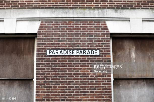 A street sign for Paradise Parade hangs on a brick wall in King's Lynn UK on Tuesday Aug 29 2017 In the town of Kings Lynn in rural eastern England...