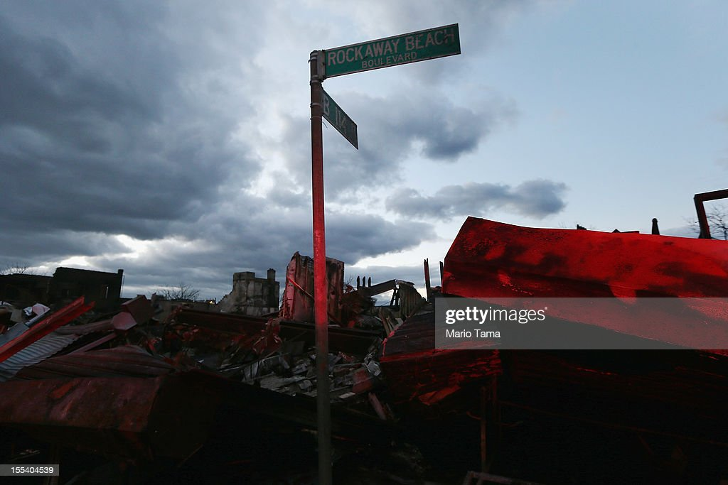 A street sign for Rockaway Beach Boulevard remains standing following a large fire in the aftermath of Superstorm Sandy at Rockaway Park on November 3, 2012 in the Queens borough of New York City. Most of the Rockaway Peninsula remains without power. With the death toll currently over 90 and millions of homes and businesses without power, the US east coast is attempting to recover from the effects of floods, fires and power outages brought on by Superstorm Sandy.