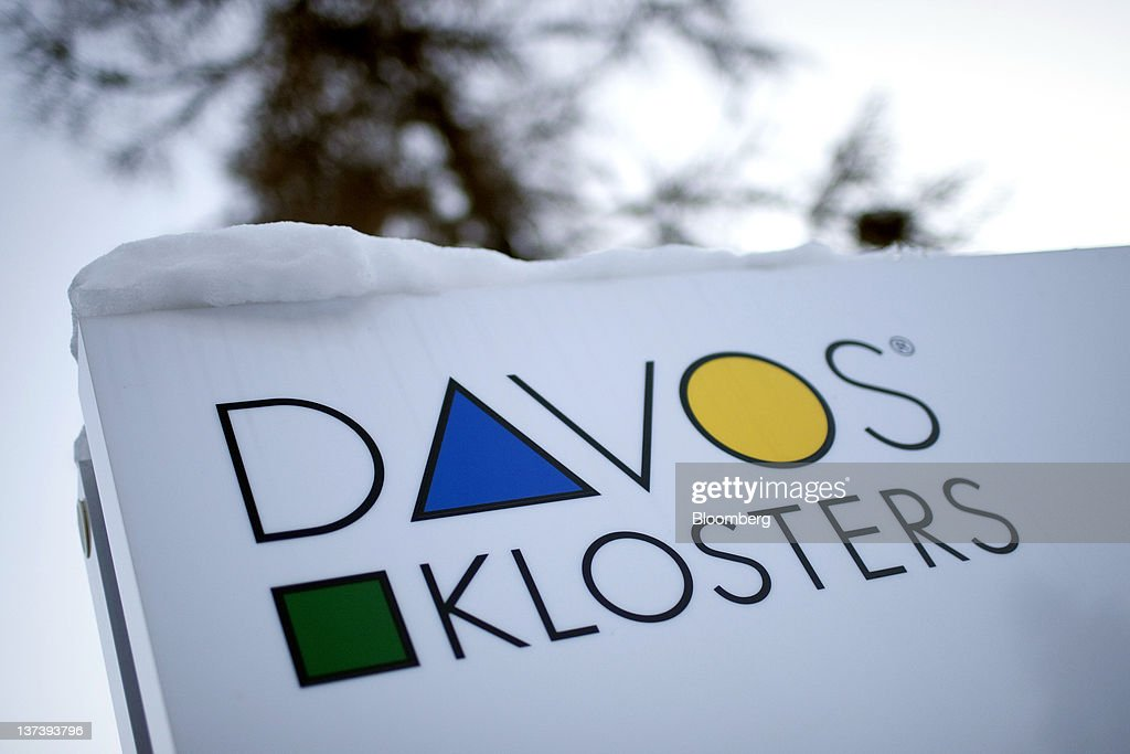 A street sign for the Swiss resorts of Davos and Klosters, is seen outside the Congress Centre, the venue of the World Economic Forum's (WEF) 2012 annual meeting, in the town of Davos, Switzerland, on Wednesday, Jan. 18, 2012. German Chancellor Angela Merkel will open next week's World Economic Forum in Davos, Switzerland, which will be attended by policy makers and business leaders including U.S. Treasury Secretary Timothy F. Geithner. Photographer: Scott Eells/Bloomberg via Getty Images