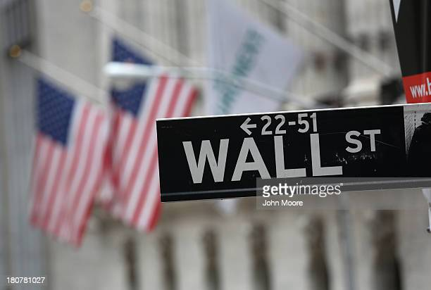 A street sign for Wall Street hangs outside the New York Stock Exchange on September 16 2013 in New York City Five years after the beginning of the...