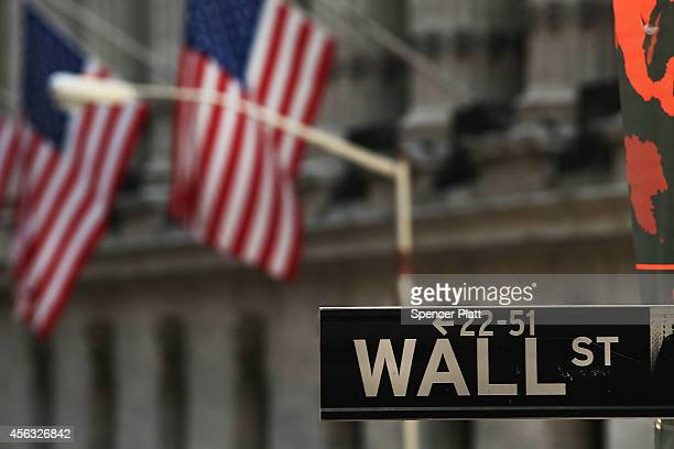 A street sign for Wall Street near the New York Stock Exchange on September 29 2014 in New York City In morning trading the Dow opened down more than...