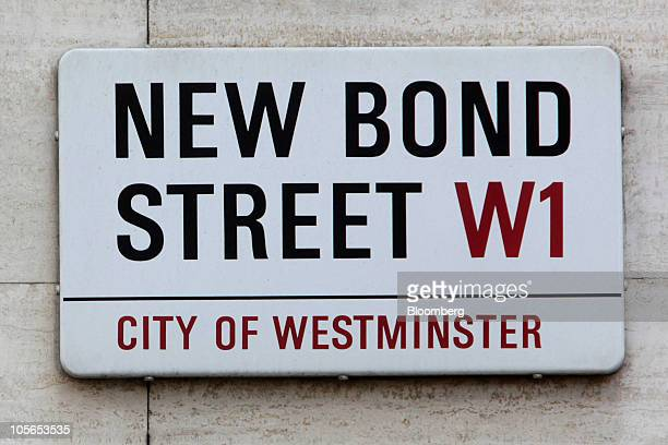 A street sign hangs on New Bond Street in London UK on Monday Oct 18 2010 UK consumer spending ''is likely to be fairly restrained in 2011'' the...