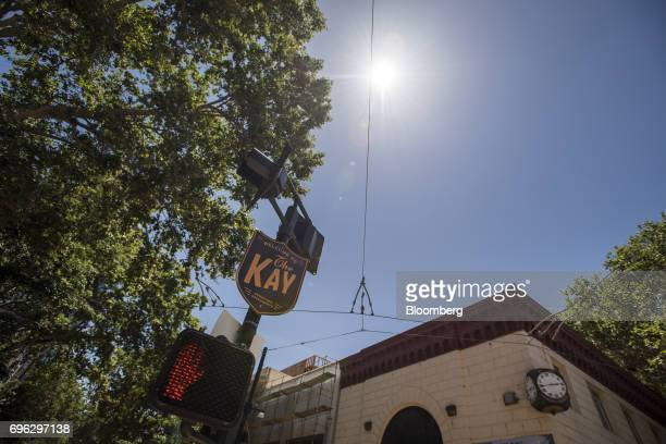 A K Street sign is displayed in the downtown area of Sacramento California US on Tuesday June 6 2017 As the cost of daily life tests the bounds of...