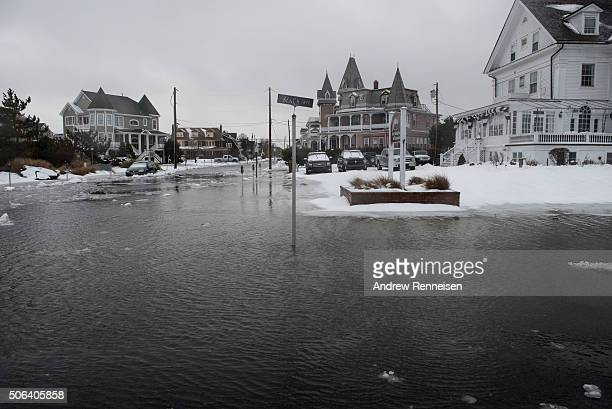 A street sign is surrounded by water as the winter storm mixed with high tide causes flooding on Beach Avenue on January 23 2016 in Cape May New...
