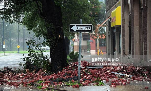 A street sign is turned upside down likely resulting from bricks falling overnight from a building along the deserted streets of New Orleans...