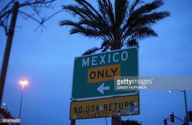 A street sign leading into Mexico atThe United StatesMexico Border wall near the San Ysidro Port of Entry in San Ysidro California on Friday February...