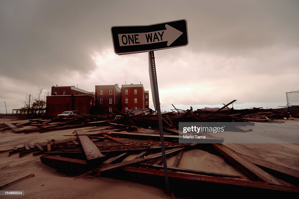 A street sign stands near apartment buildings which flooded and destroyed large sections of an old boardwalk, on October 30, 2012 in Atlantic City, New Jersey. The storm has claimed at least 33 lives in the United States, and has caused massive flooding across much of the Atlantic seaboard. US President Barack Obama has declared the situation a 'major disaster' for large areas of the US East Coast including New York City.