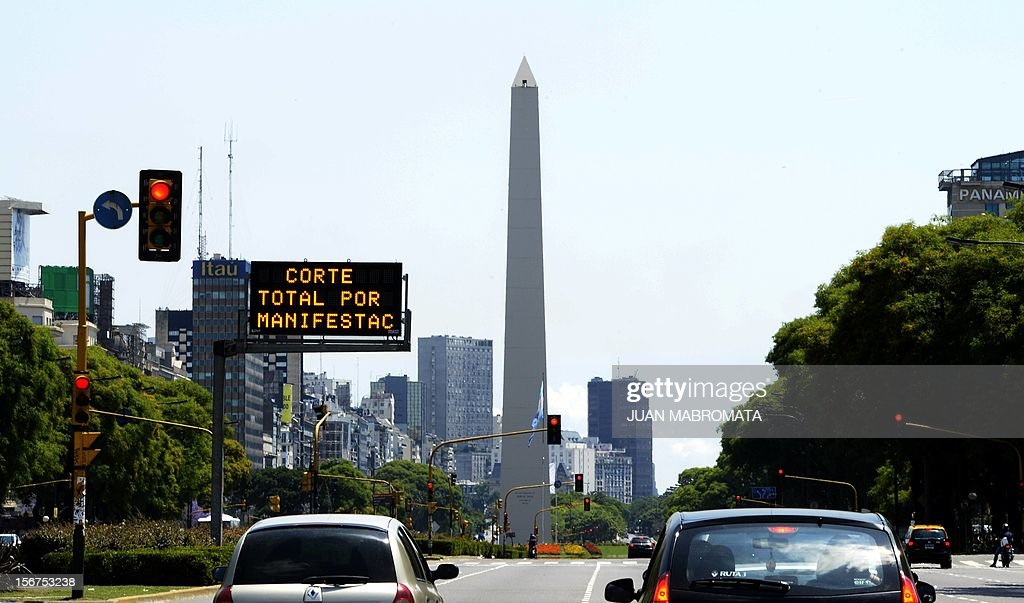 A street sign warns about the blockage of the avenue due to a demonstration during a unions' strike that blocks the approaches to the capital, on November 20, 2012 in Buenos Aires. A general strike was called Tuesday by the working unions opposing the government of President Cristina Fernandez de Kirchner to protest against the taxes on wages. AFP PHOTO / Juan Mabromata