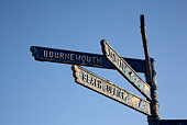 sign post on the beach at alum chine pointing towards bournemouth dorset england uk