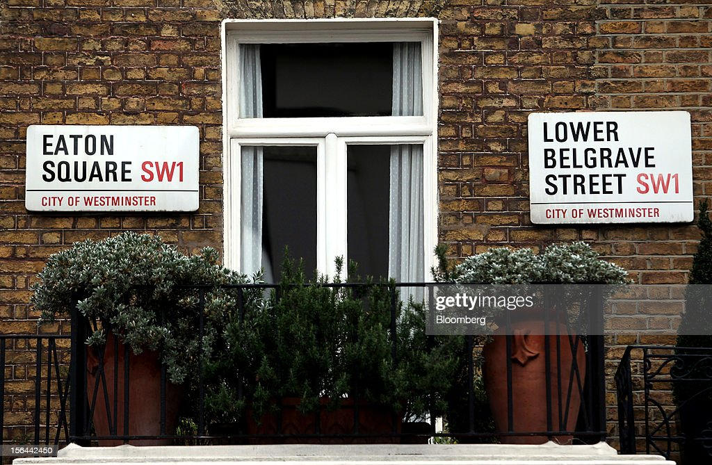 Street signs for Eaton Square and Lower Belgrave Street are seen on a property in the London area of Belgravia, in London, U.K., on Thursday, Nov. 15, 2012. London luxury homes won't rise in value next year for the first time since 2008 as proposals to extend property transaction taxes deter buyers, Jones Lang LaSalle Inc. said. Photographer: Chris Ratcliffe/Bloomberg via Getty Images