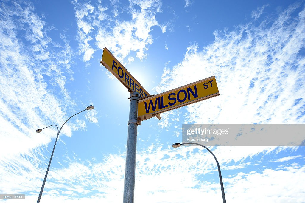 Street signs for Wilson and Forrest streets stand in the mining town of Kalgoorlie, Australia, on Thursday, Aug. 8, 2013. Western Australia, the nation's largest state by area with 2.6 million square kilometers (1 million square miles) of land, earned A$97 billion from minerals and energy sales in 2012, down from A$108 billion in 2011, according to government figures. Photographer: Carla Gottgens/Bloomberg via Getty Images