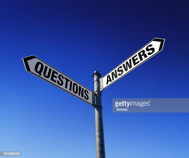 Street signs gesturing to two paths, questions and answers