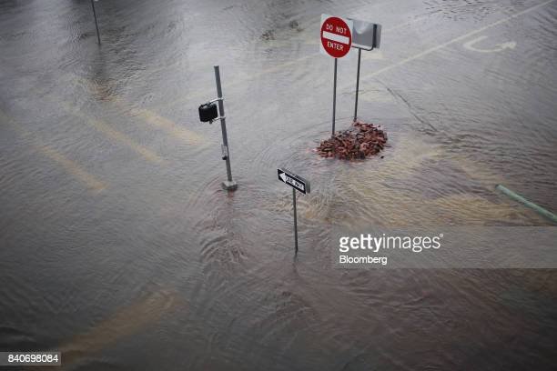 Street signs stand in floodwaters from Hurricane Harvey in Dickinson Texas US on Tuesday Aug 29 2017 Estimates for damages caused by Hurricane Harvey...