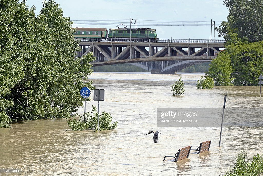 Street signs stand in water at Wisla river in Warsaw on May 21, 2010.Flash floods caused by days heavy rainfall have hit parts of central Europe, killing at least seven people, disrupting power supplies and forcing thousands of people from their homes. Southern Poland, parts of the Czech Republic and Slovakia and northern Hungary are among the worst affected regions